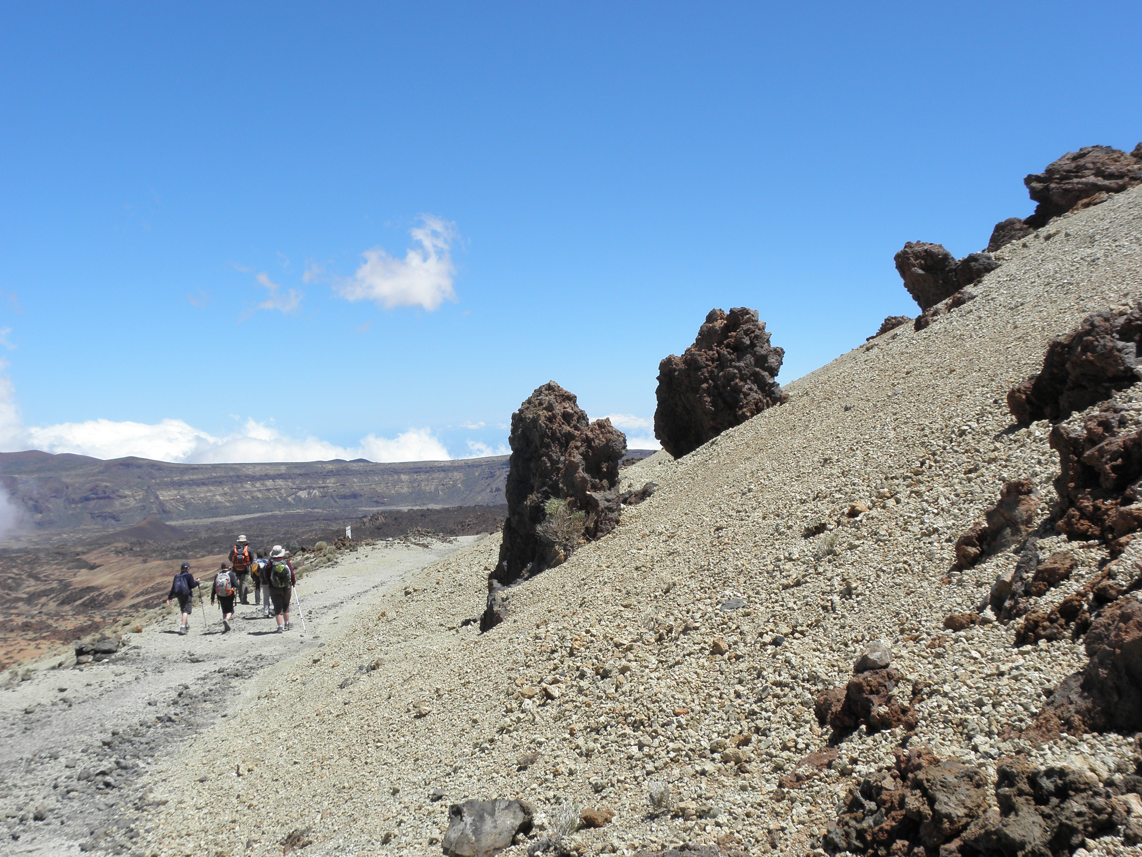 Group of walkers on pumice stones floor in the Teide national park