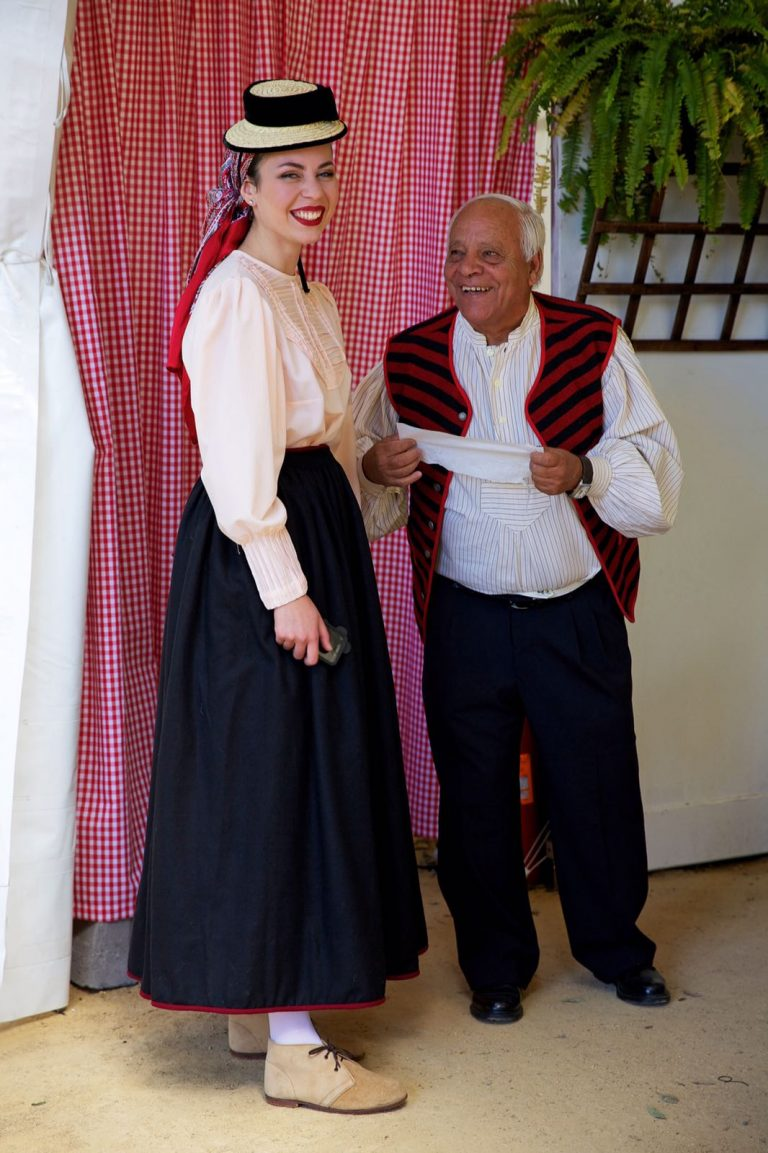 Canarian young woman and senior man in traditional costumes