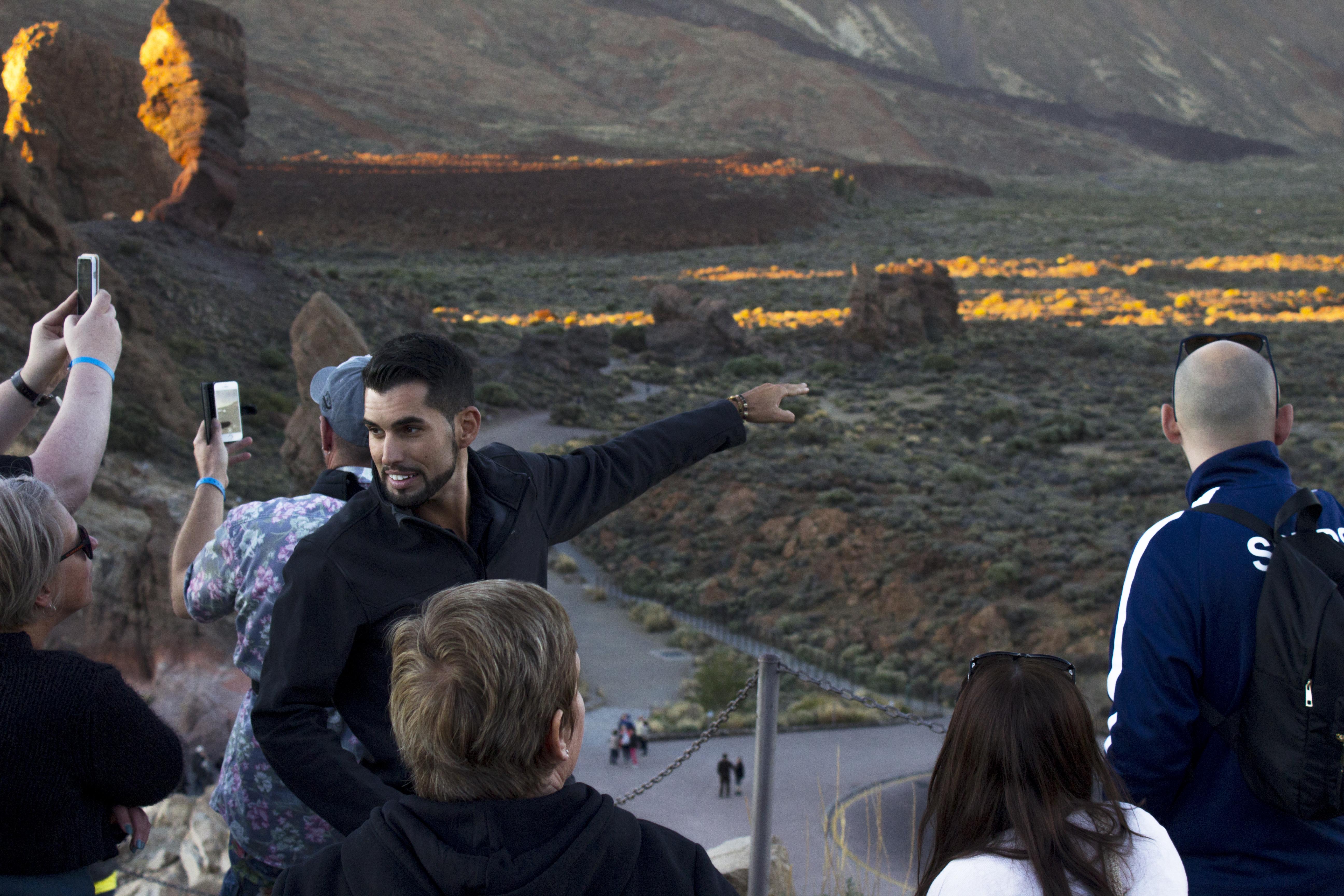 tour guide explaining the Teide national park landscape to a group